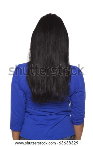 Isolated studio shot of a casually dressed Latina woman facing away from the camera. - stock photo