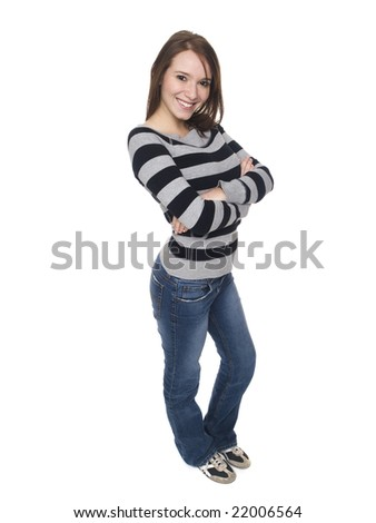 Isolated studio shot of a casually dressed young adult female college student smiling at the camera. - stock photo