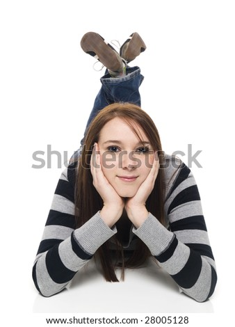 Isolated studio shot of a casually dressed young adult woman laying on the floor and looking attentively at the camera. - stock photo