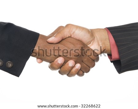 Isolated studio shot of a closeup view of an African American man and woman shaking hands to seal the deal.