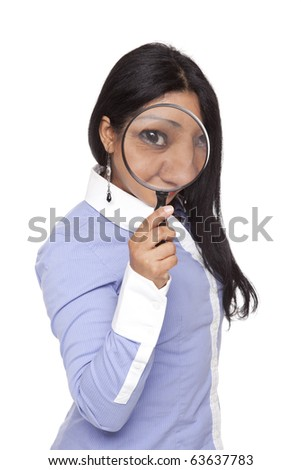 Isolated studio shot of a Latina businesswoman searching for something using a magnifying glass.