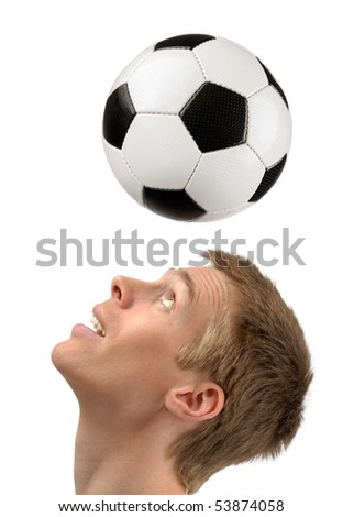 Isolated studio shot of a young soccer player playing the ball with his head - stock photo