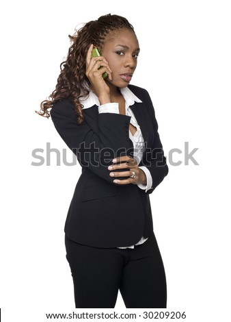 Isolated studio shot of an upset businesswoman talking on her cellphone. - stock photo