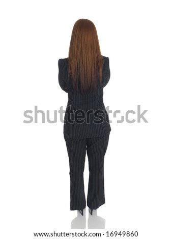 Isolated studio shot of the back side of a businesswoman standing with arms crossed.