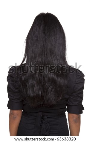 Isolated studio shot of the rear view of a Latina businesswoman. - stock photo