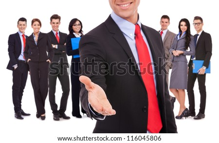 Isolated successful business team, focus on man with handshake gesture. young business man welcoming to the team with a handshake