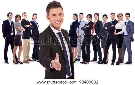 Isolated successful business team, focus on man with handshake gesture. young business man welcoming to the team