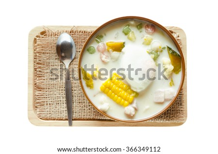 isolated Thai dessert on with clipping path, dumpling sweetmeat with coconut cream adding boiled egg and cereal - stock photo