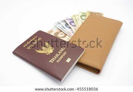 Isolated Thai passport with Chinese banknotes and a brown envelope