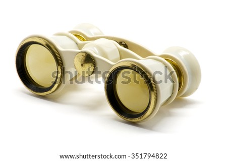 Isolated theater white binoculars with golden ring over white - stock photo