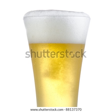 Isolated three quarter portrait of full beer in pilsner style glass with head just above rim