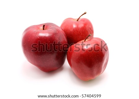 isolated three red apples on white background