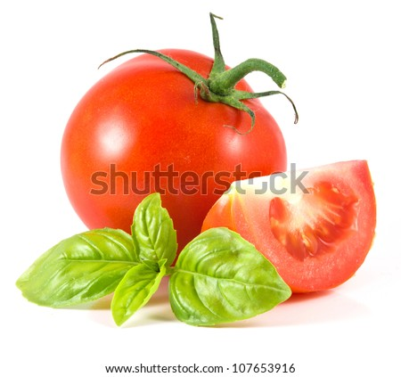 isolated tomato with leaf of basil on white