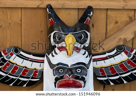 Isolated totem wood pole head detail - stock photo