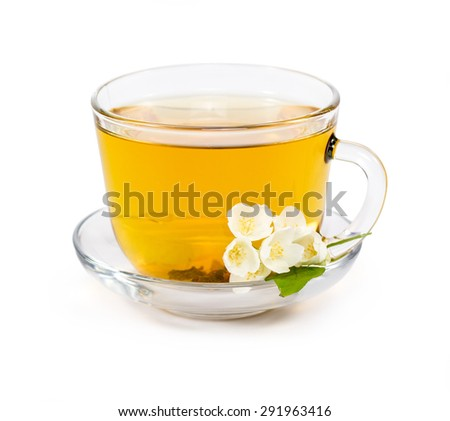 isolated transparent cup of tea with jasmine flowers - stock photo