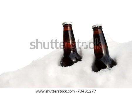 isolated two beers in the snow - stock photo