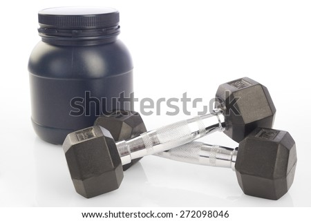 Isolated two dumbbells and protein powder bottle on white background