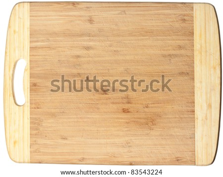 Isolated used wooden cutting board. Clipping path included - stock photo