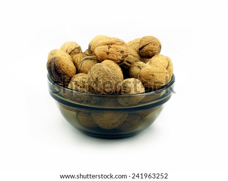 Isolated Walnuts in the bowl - stock photo