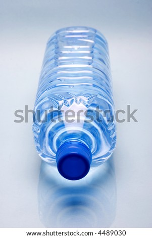 isolated water bottle on white reflective background