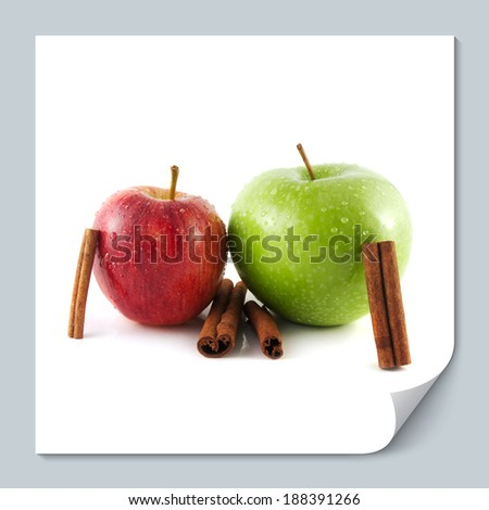 Isolated wet green and red apples with cinnamon pods (white background). Fresh diet fruit. Healthy fruit with vitamins.