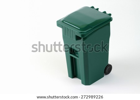 Isolated wheeled green trash can - stock photo