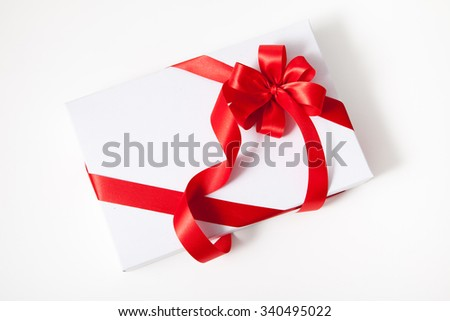 Isolated white box, bow and ribbon on white background