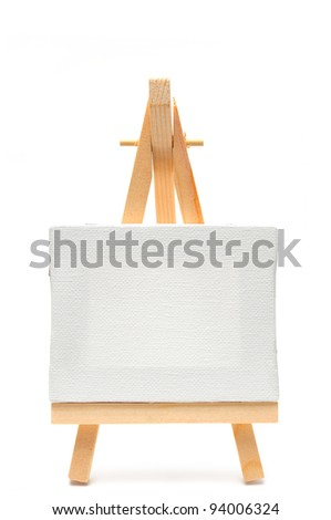 Isolated white canvas on easel - stock photo