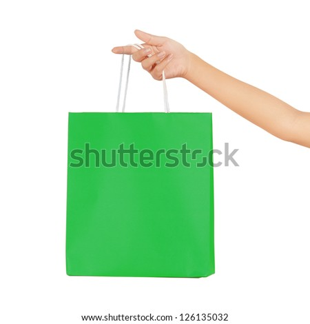 Isolated woman hand carries a shopping bag - stock photo