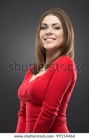 Isolated woman portrait. Smiling and happy girl over gray background - stock photo