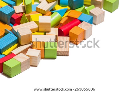 isolated wooden blocks lying in line isolated over white background - stock photo
