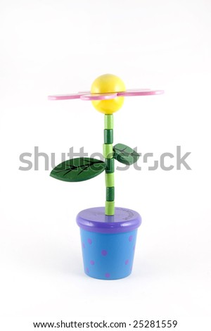 Isolated wooden flower toy - stock photo