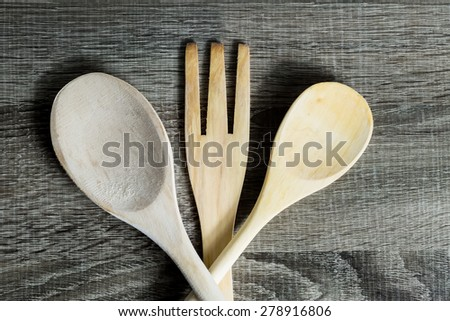 Isolated Wooden Kitchen Utensils. Spoon and fork - stock photo