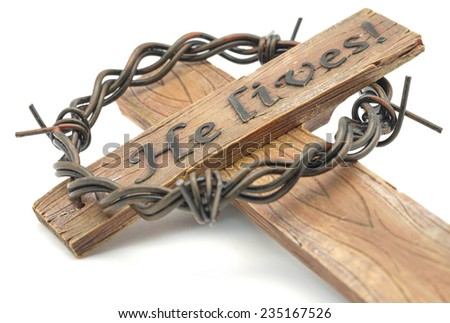 Isolated wooden rugged cross with sharp thorn and wording for religion symbol on white background - stock photo