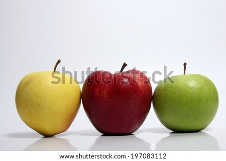 isolated yellow apples in yellow and red and green