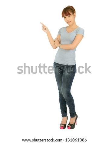 Isolated young asian woman pointing  on white.