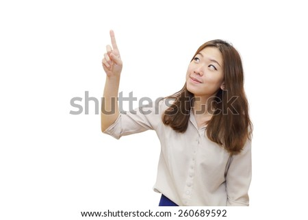 isolated young asian woman pointing upwards - stock photo