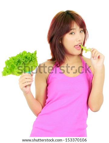 Isolated young asian woman with a bowl of vegetable salad - stock photo