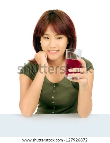 Isolated young asian woman with grapes juice over white. - stock photo