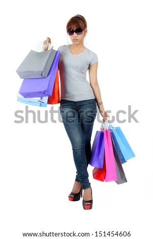 Isolated young asian woman with shopping bags - stock photo