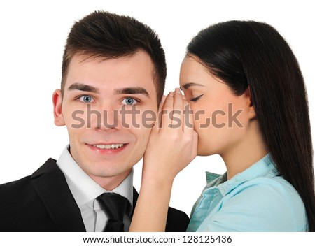 Isolated young business couple whispering - stock photo