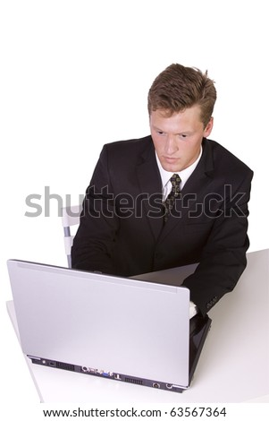 Isolated Young business entrepreneur working on laptop