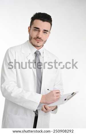 isolated young business man on a white overall coat - stock photo