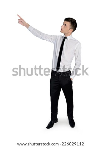 Isolated young business man pointing - stock photo