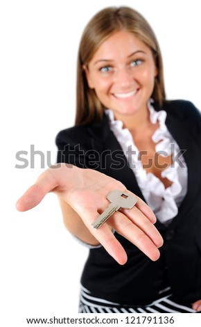 Isolated young business woman giving key