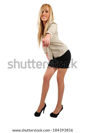 Isolated young business woman pointing you
