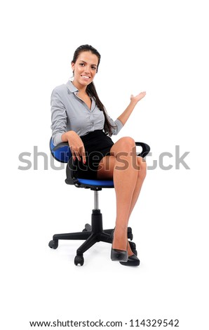 Isolated young business woman sitting - stock photo