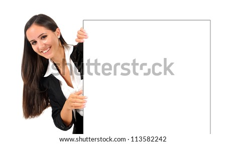 Isolated young business woman under wall - stock photo