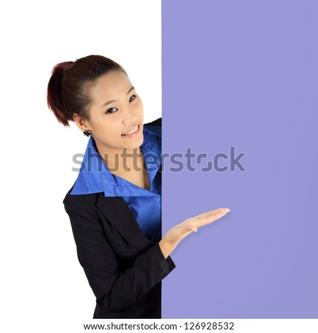 Isolated young business woman with a billboard - stock photo