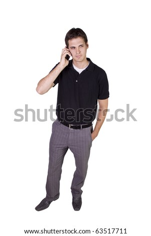 Isolated Young businessman conversing on cell phone